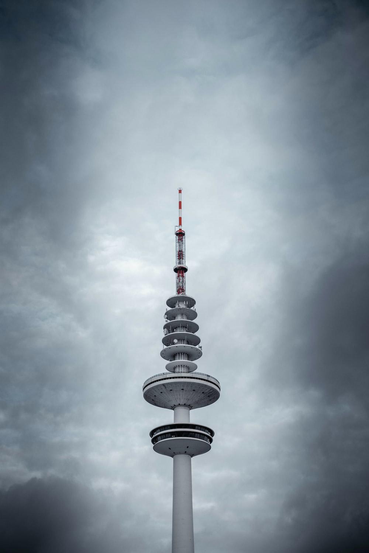 white tower under nimbus clouds