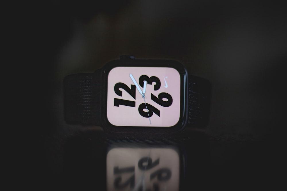 square black Nike analog watch at 3:10