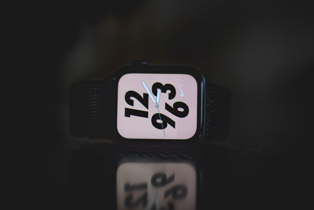 square black Nike analog watch at 3:10