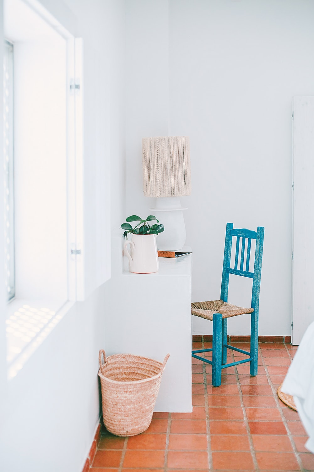 white wooden desk with green chair inside room