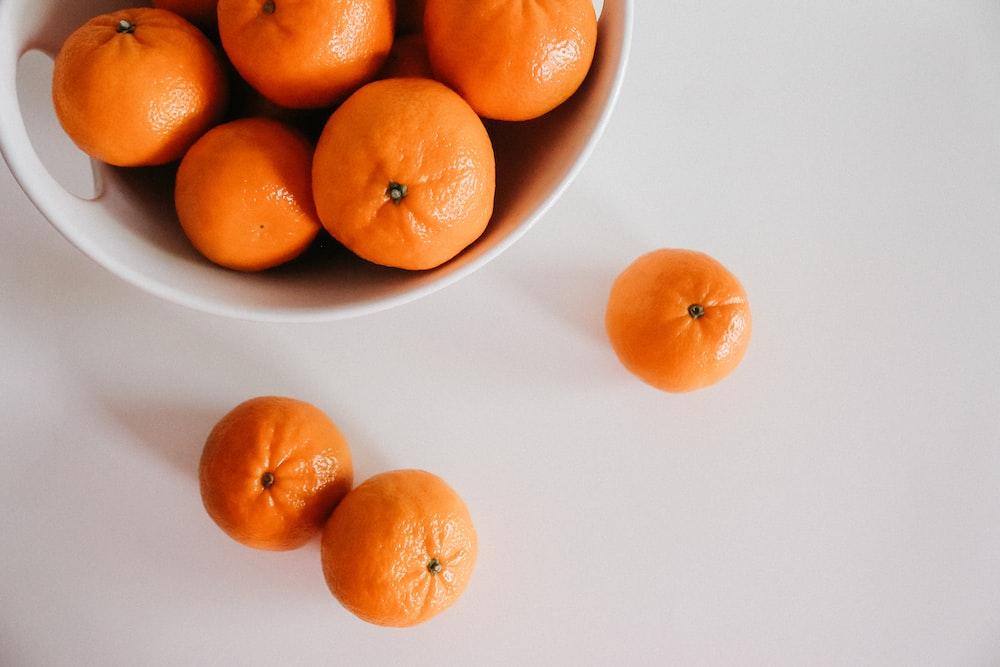 orange citrus fruits on in bowl