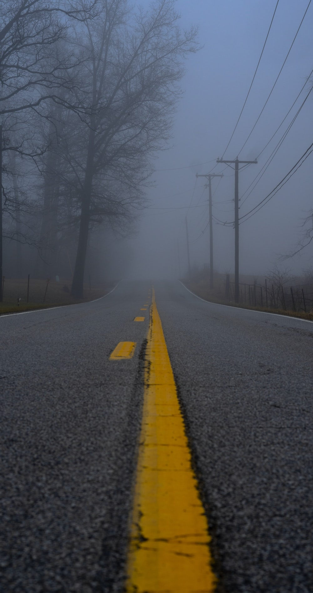 concrete road during foggy weather