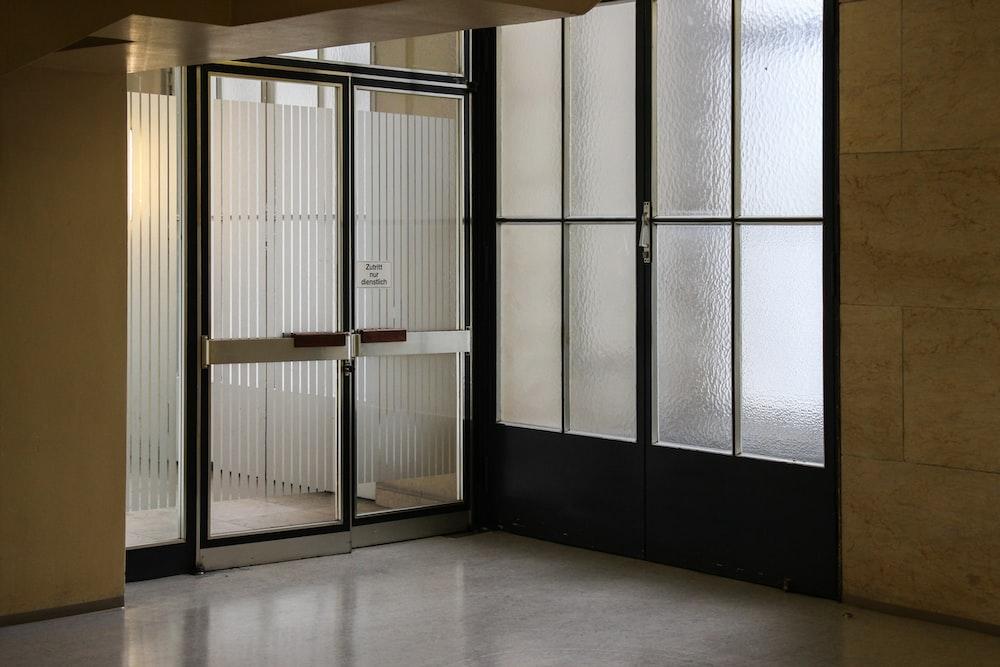 closed gray stainless steel framed glass door