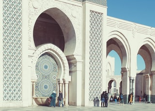 people walking beside triumphal arch
