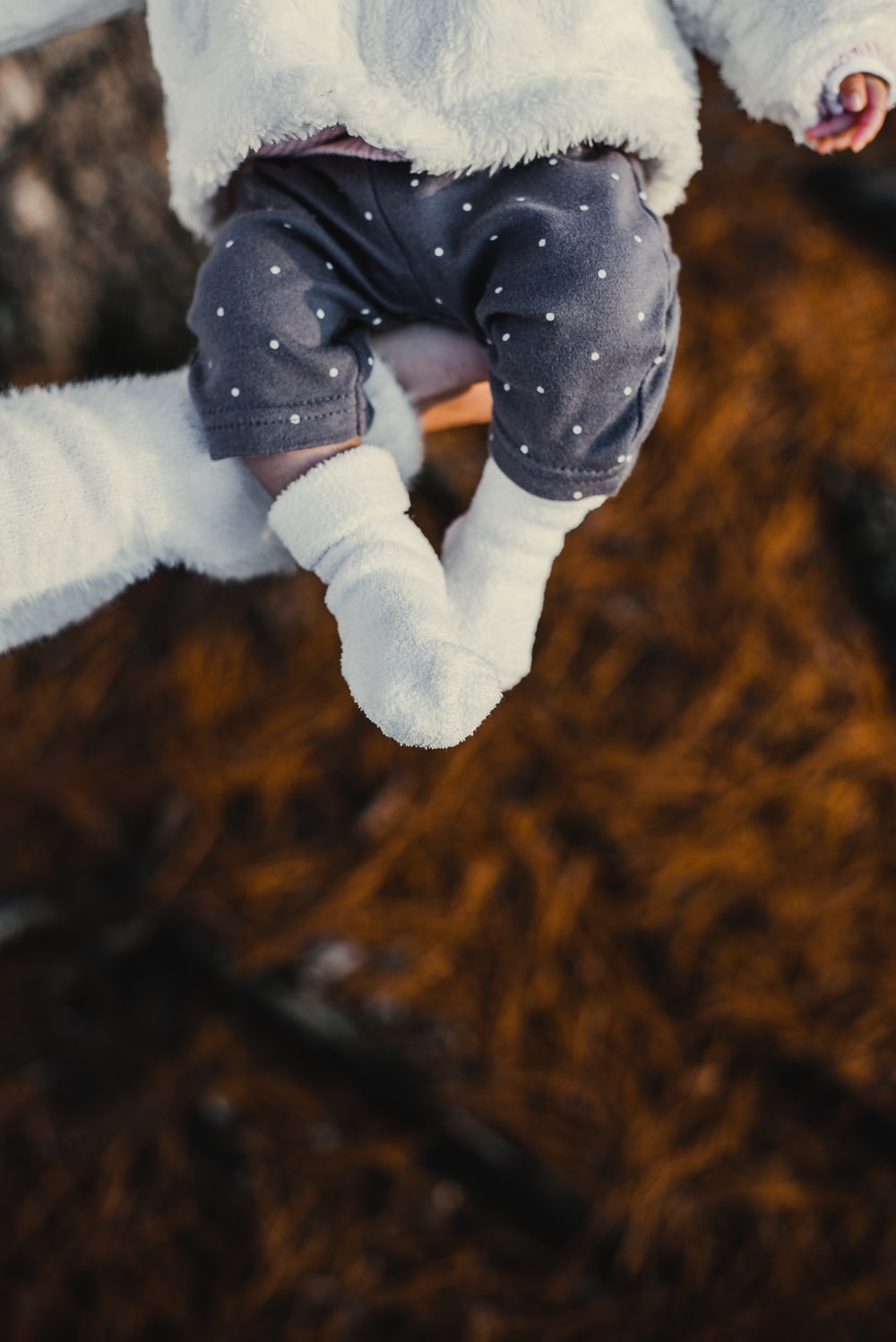 person carrying baby close-up photo