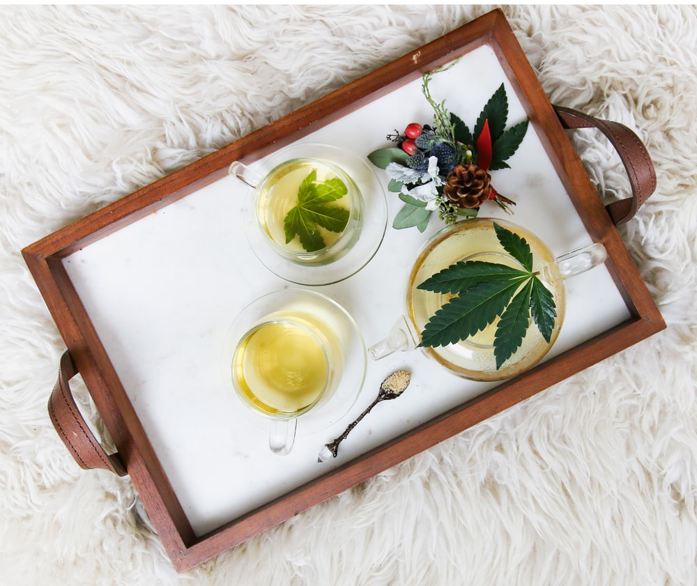 rectangular brown wooden tray filled with tea
