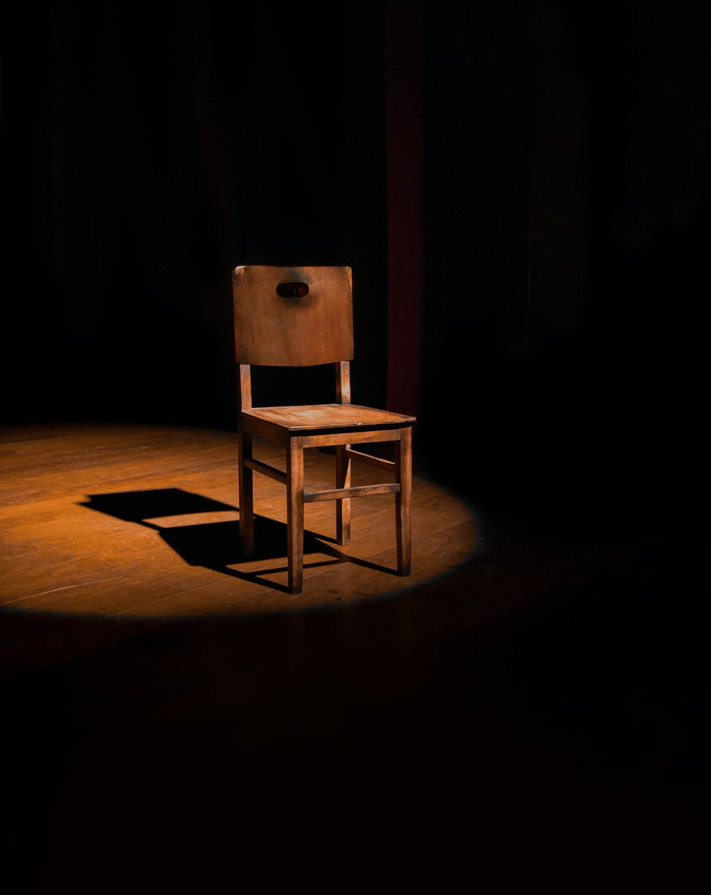 vacant brown wooden armless chair