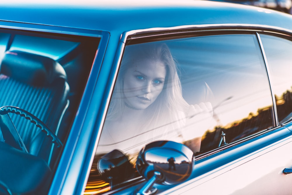 woman inside black vehicle