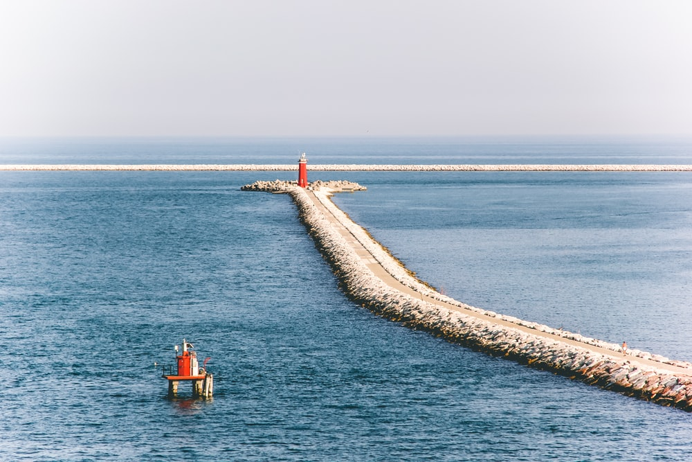 gray pathway at middle of sea