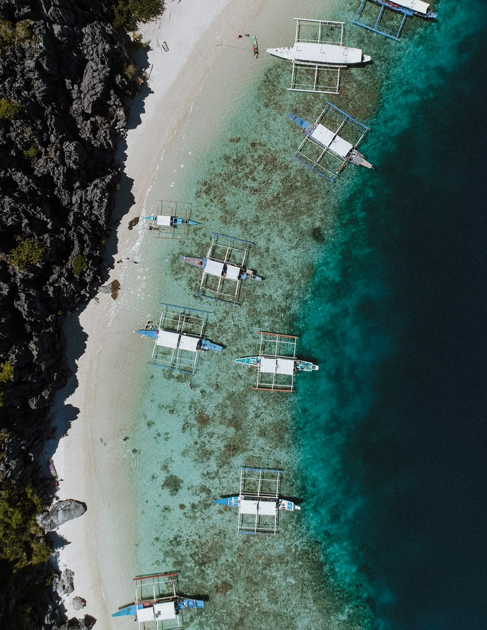 aerial photo of boats docked beside islet