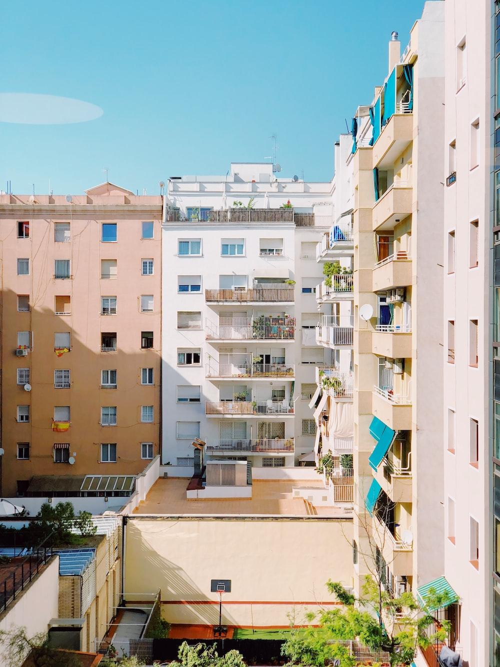 white high rise buildings under blue sky