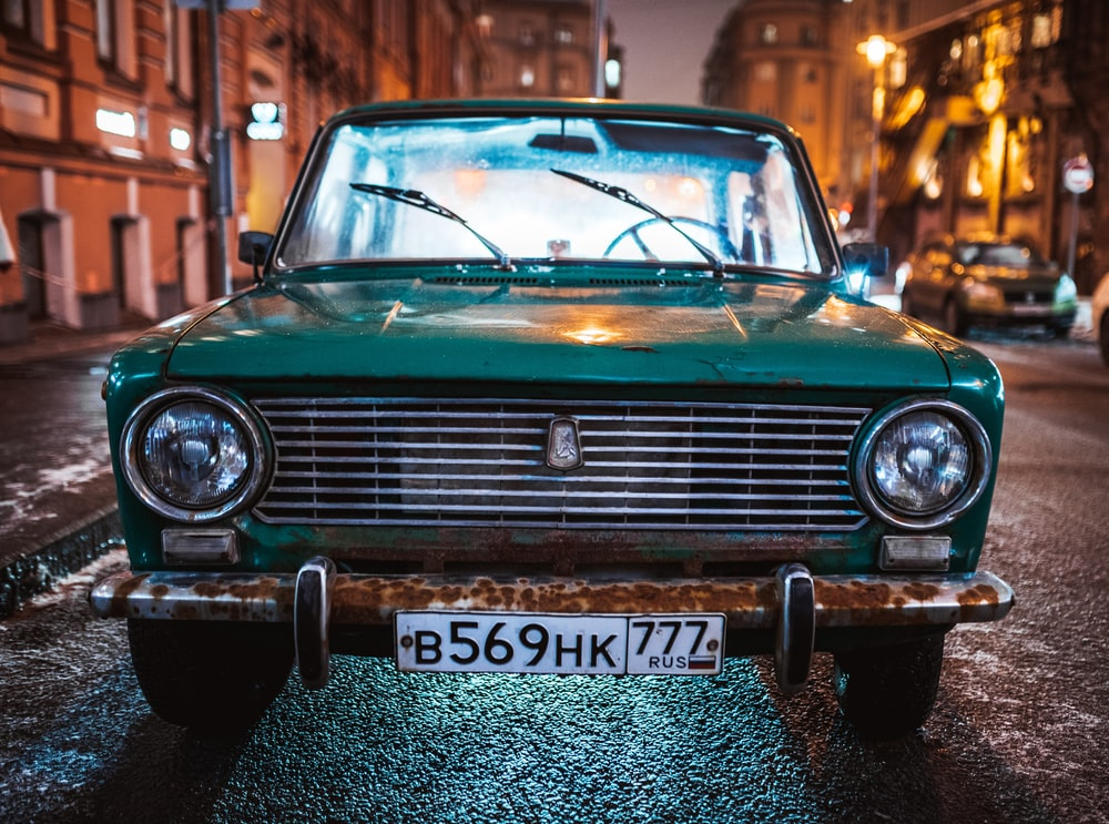 green Tofas Murat parked on roadside during nighttime