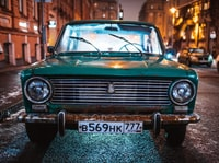 green Tofas Murat parked on roadside during nighttime