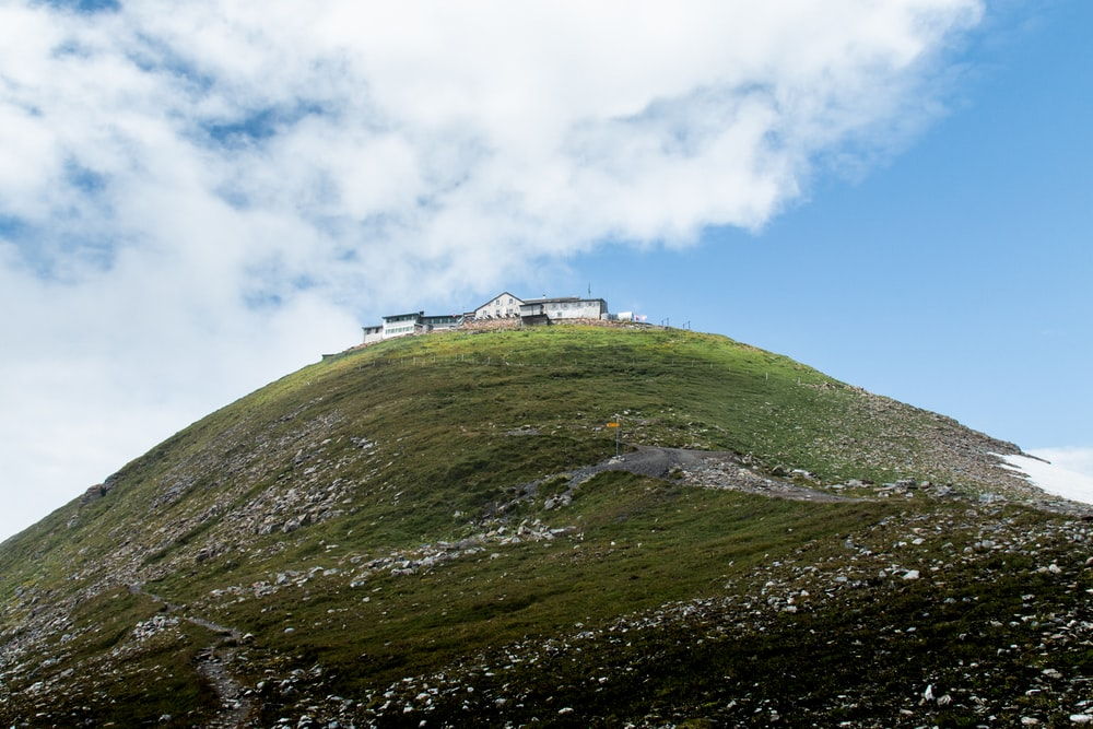 house on top of hill under blue sky