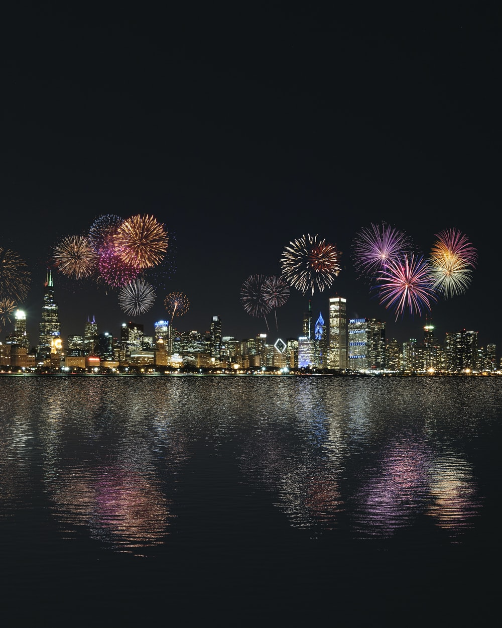 skyline buildings under fireworks display