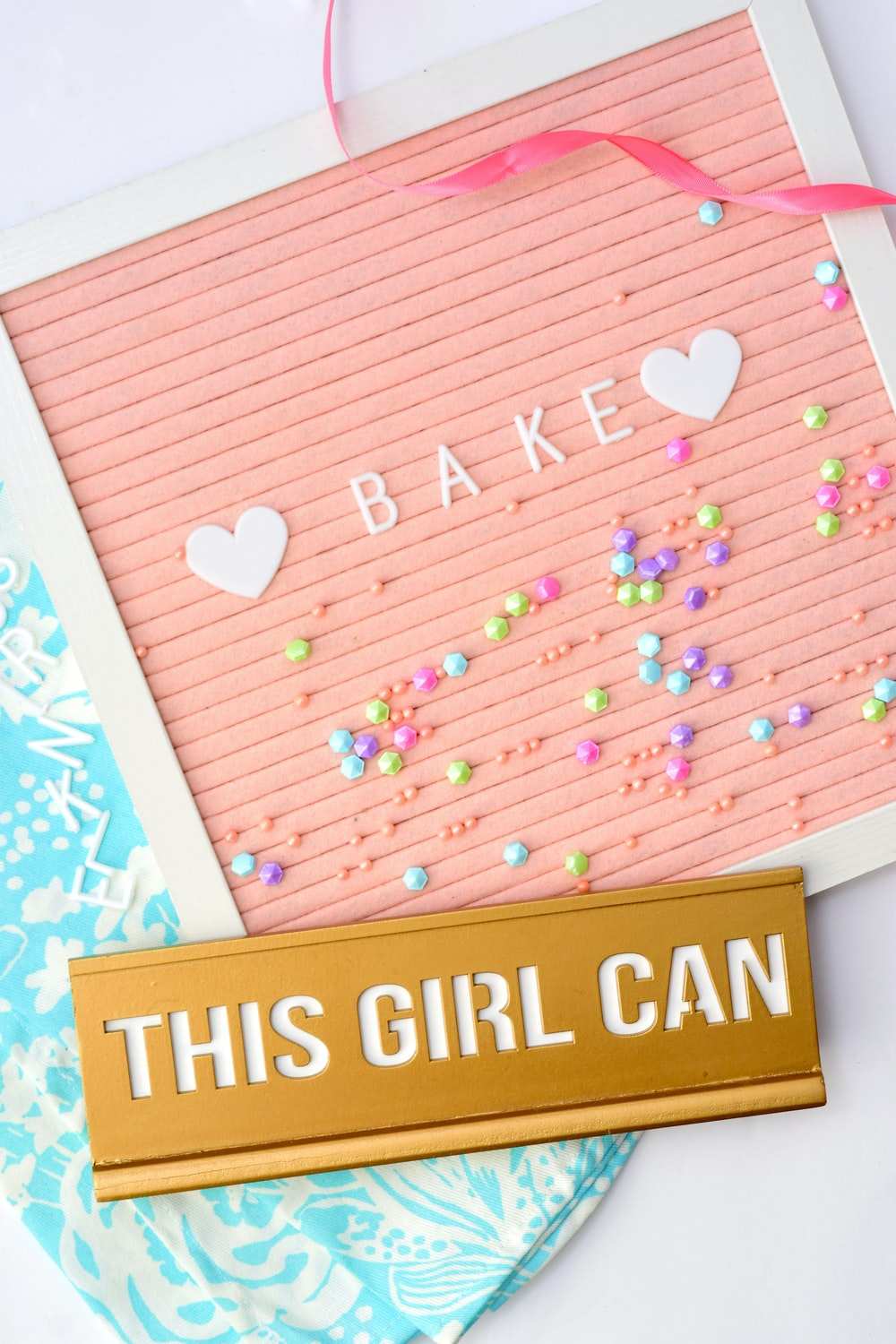white and pink wooden bake sign