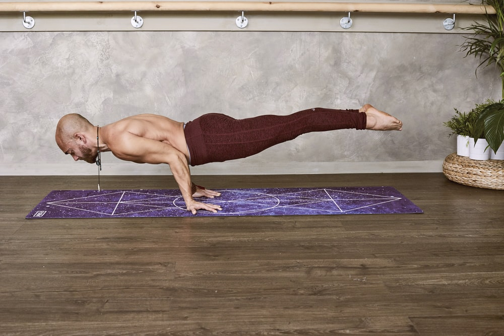 woman push-up his whole body on purple mat