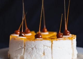 selective focus photography of cheery topped cake on white plate