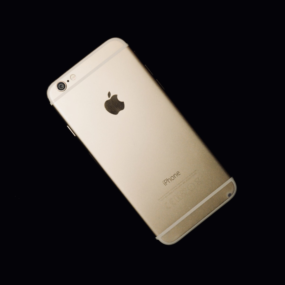gold iPhone 6 on black background