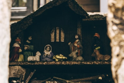 assorted-color nativity scene figurine manger teams background