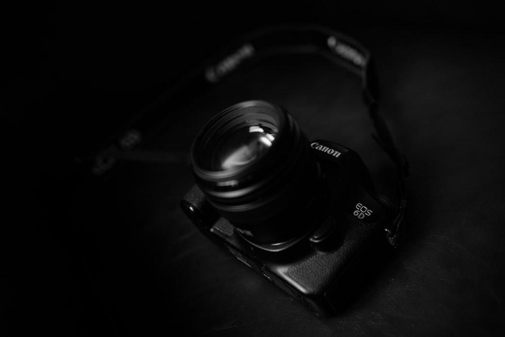 black Canon EOS 60 camera