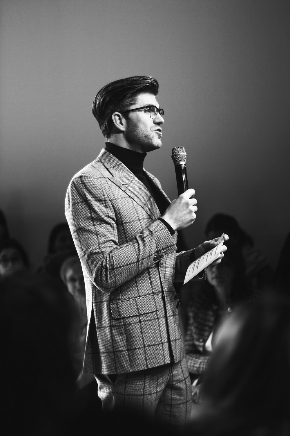 man standing while holding microphone