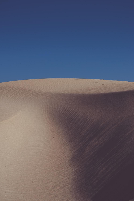 empty desert under blue sky during daytime
