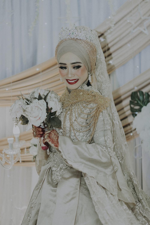 smiling woman wearing wedding dress