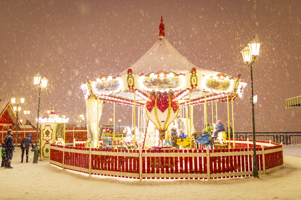 red and white carousel during snowy night