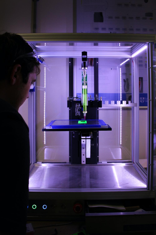 person near 3D printer