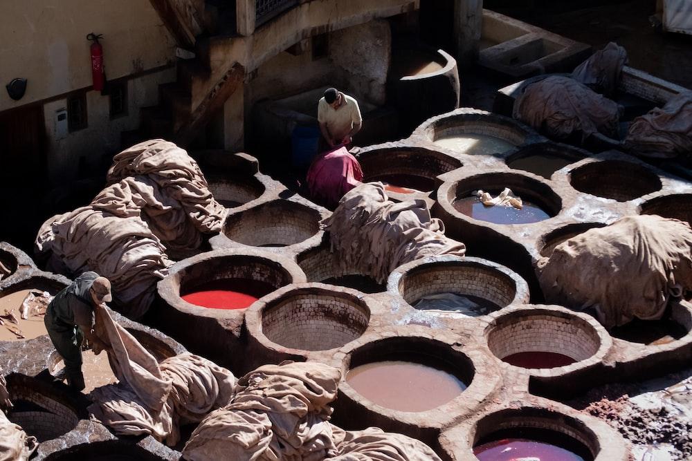 man holding brown textiles at daytime