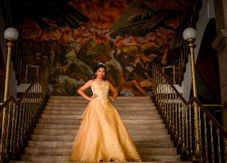 woman wearing brown dress standing on stair