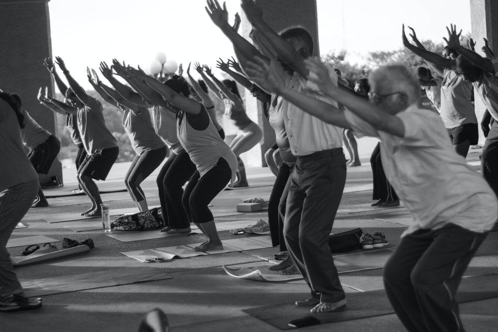 grayscale photo of people exercising