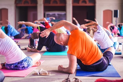 people exercising yoga teams background