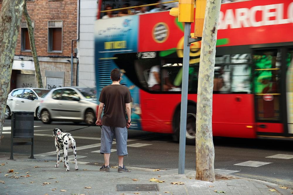 man with dog near street