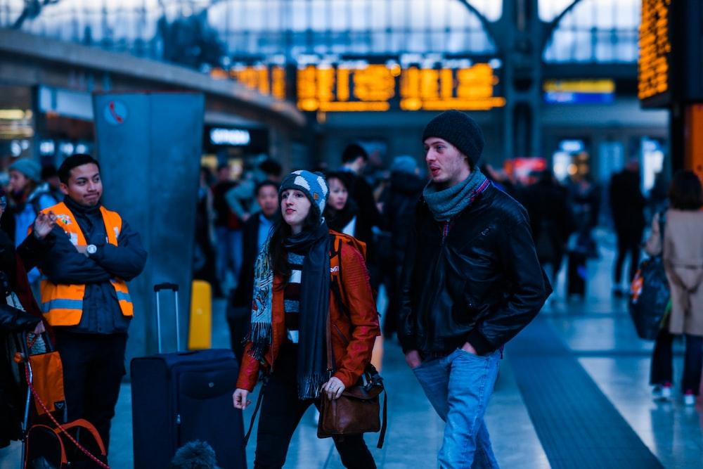 man walking beside woman during daytime
