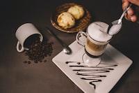 brown liquid in glass mug