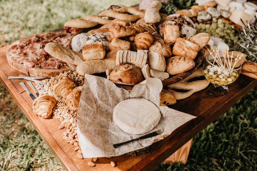 bread on brown wooden table outdoors