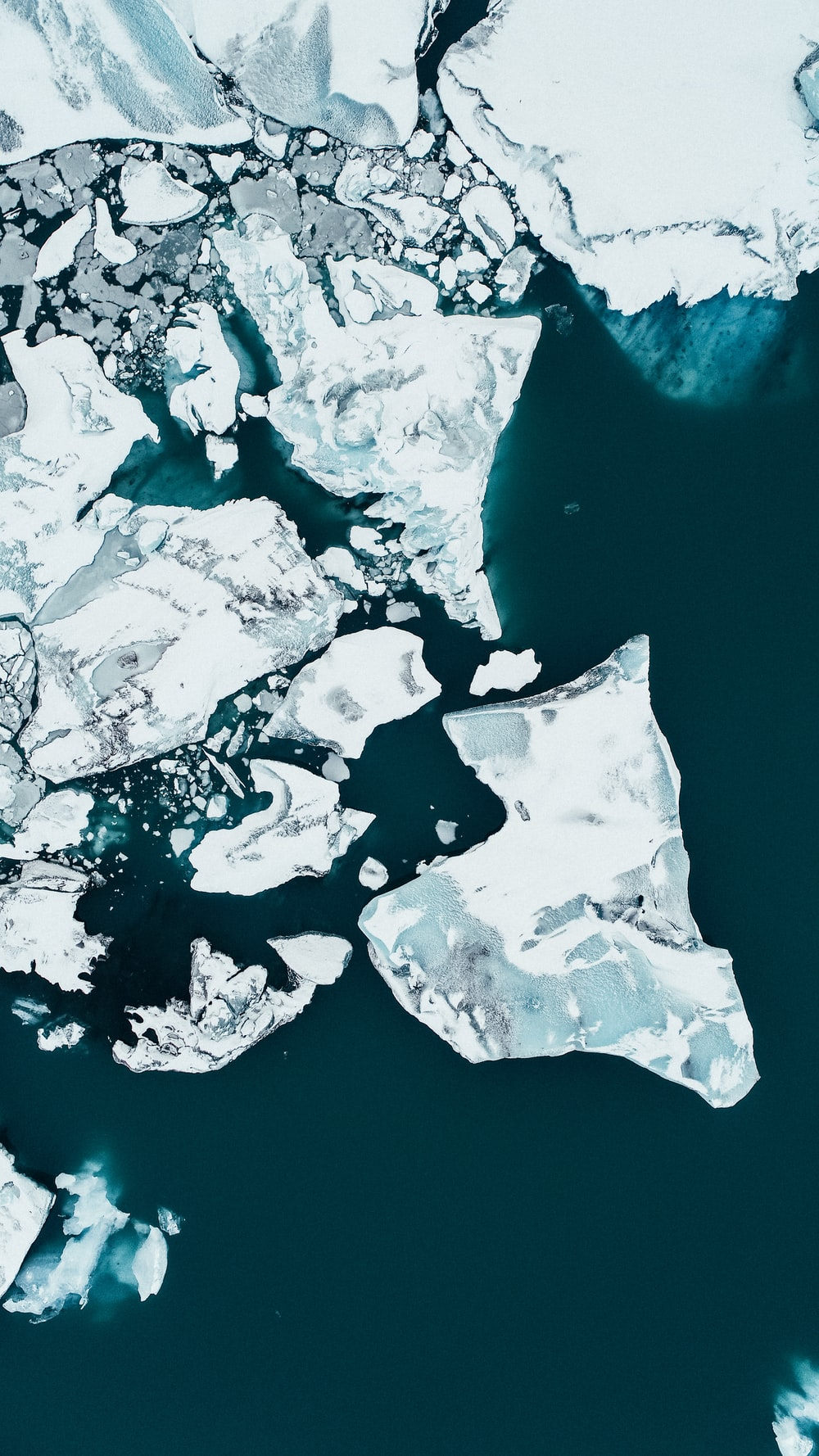 white ice on body of water during daytime