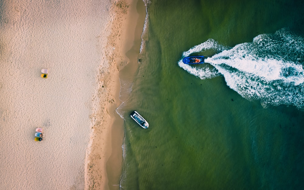 boat on blue sea during daytime