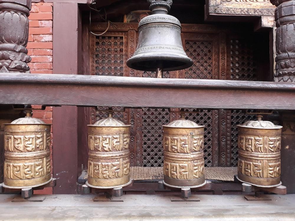 gray steel bell near door