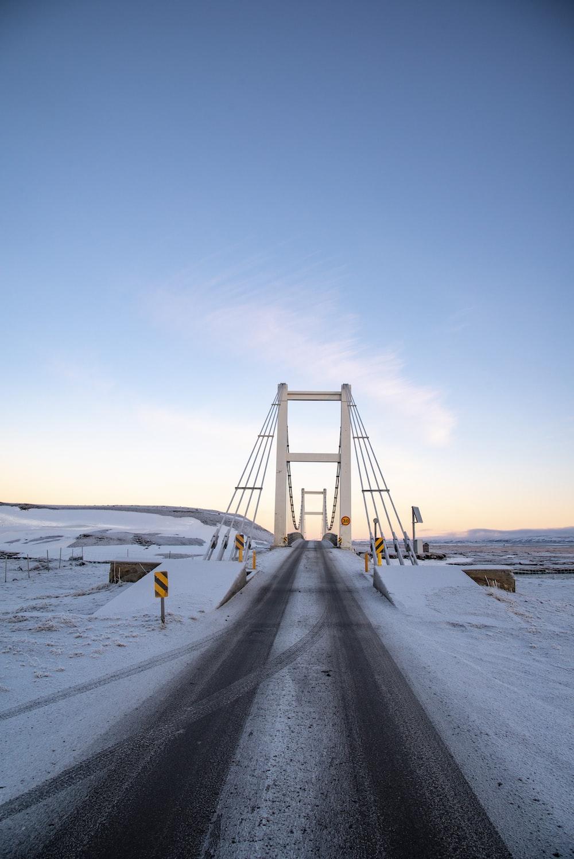 empty suspension bridge under white skies