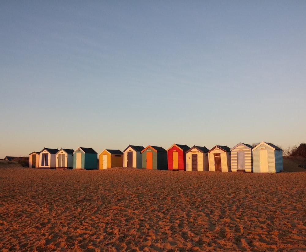 wooden sheds on desert during daytime