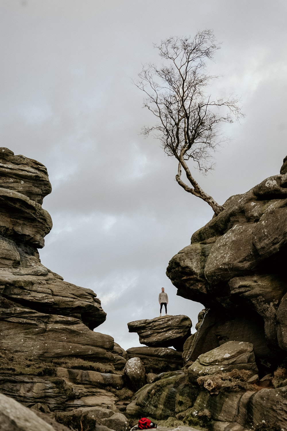 person standing on top of rock formation during daytime