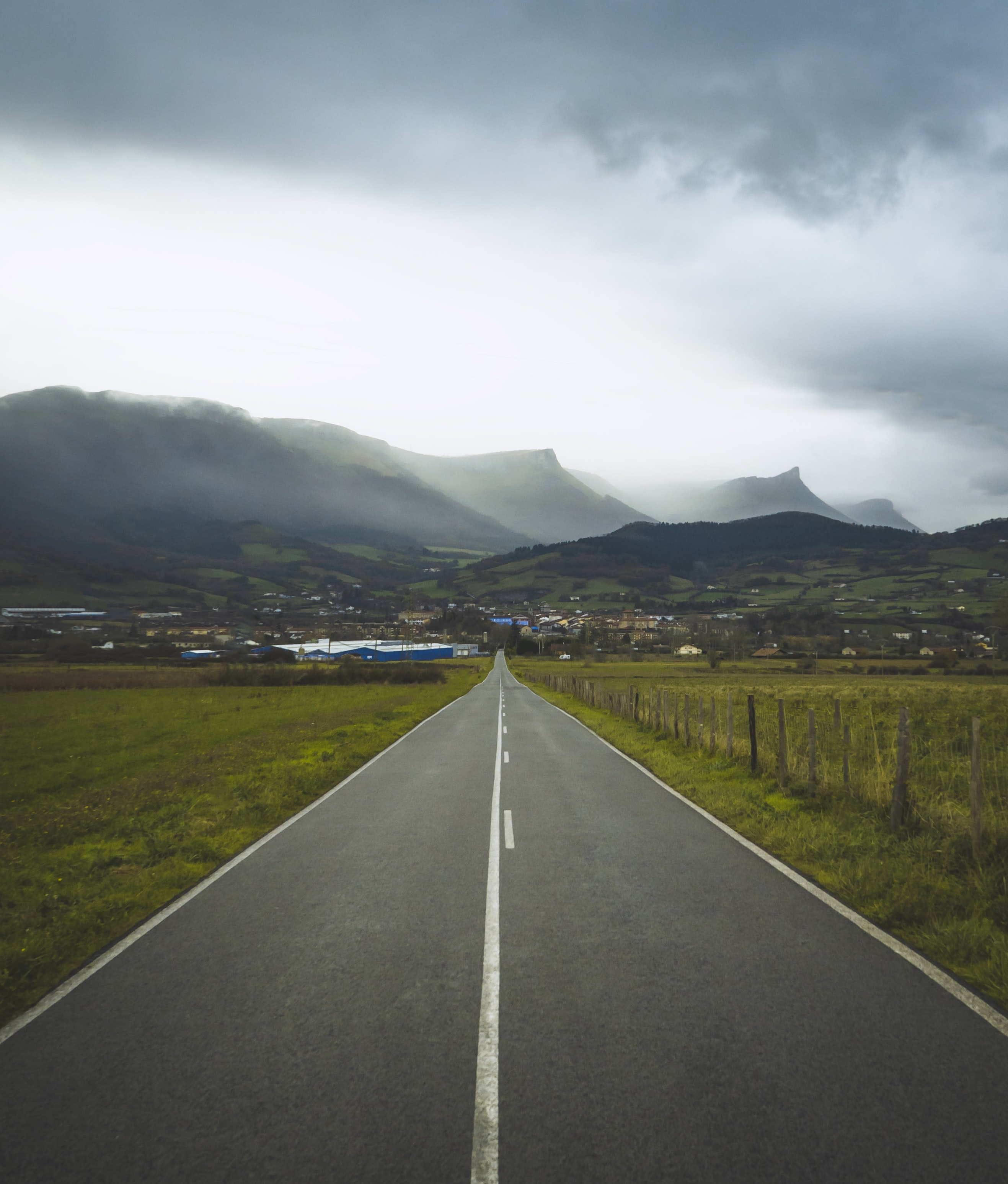 gray asphalt road and mountains