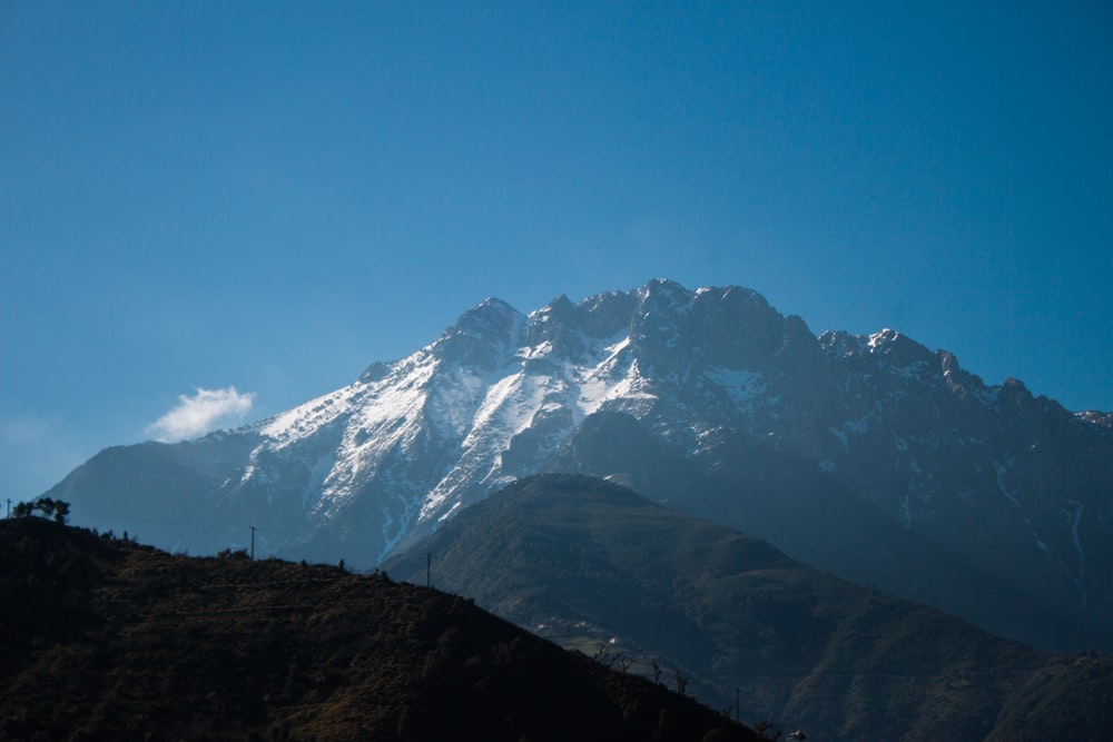 snow capped mountain range during daytime