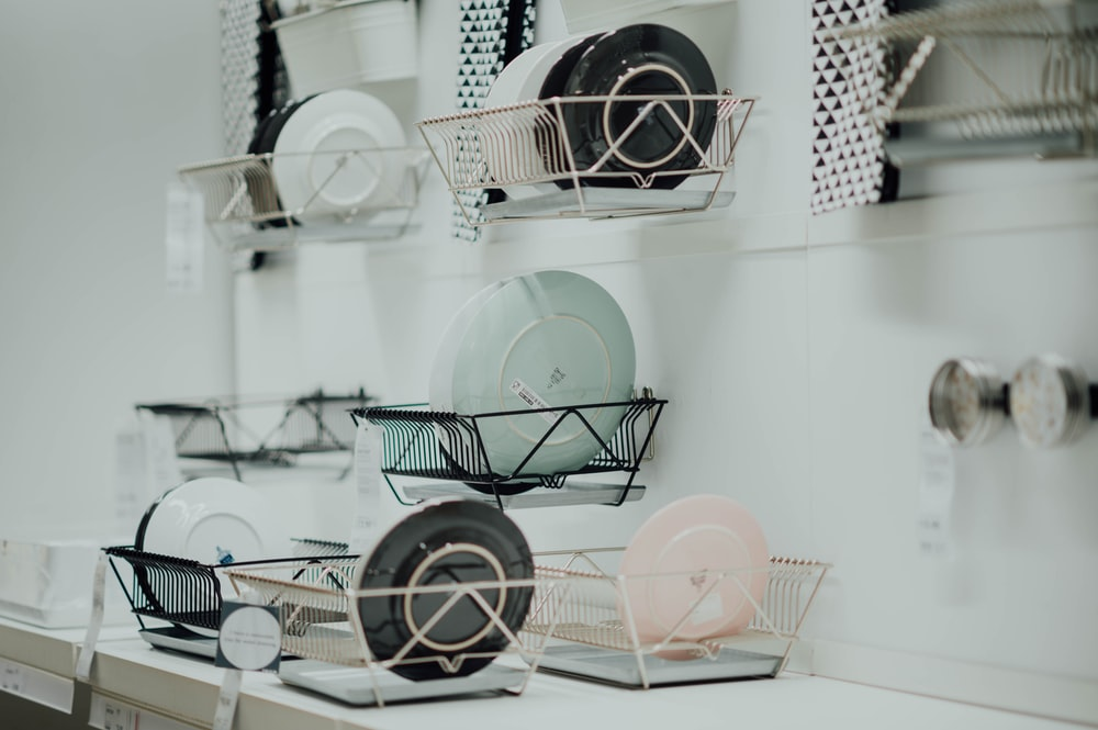 assorted-color saucers placed on rack