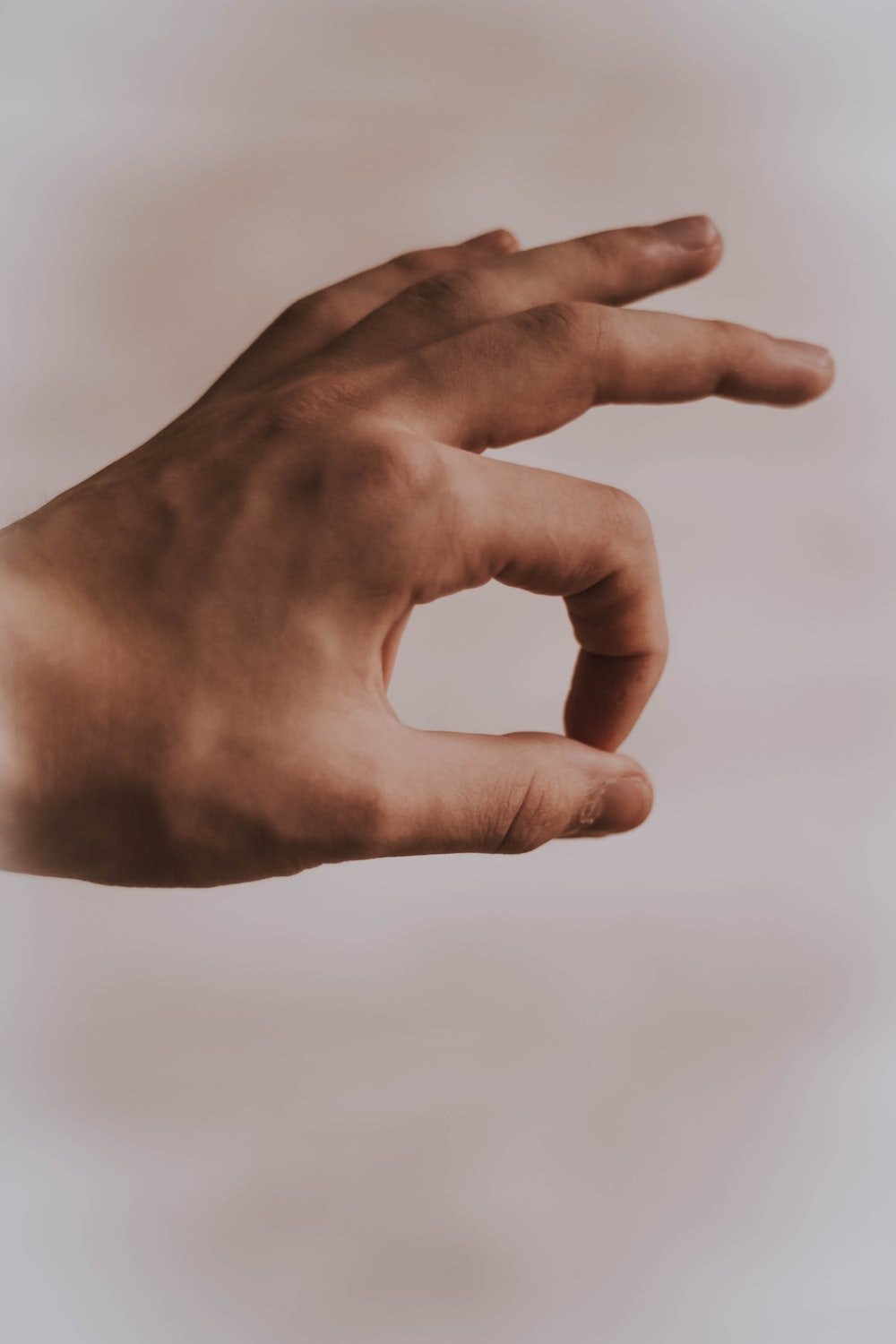 left human hand with OK sign