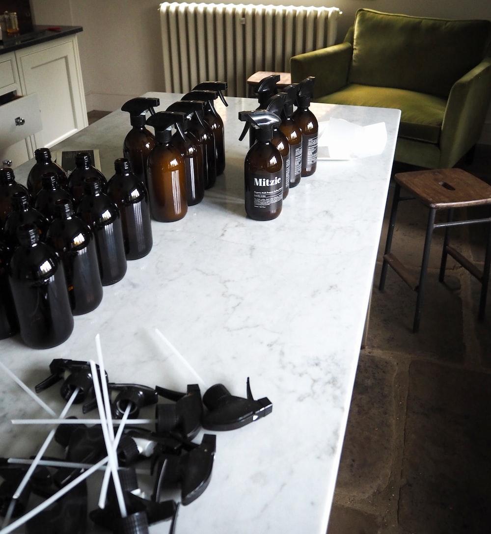 brown glass bottles on white table