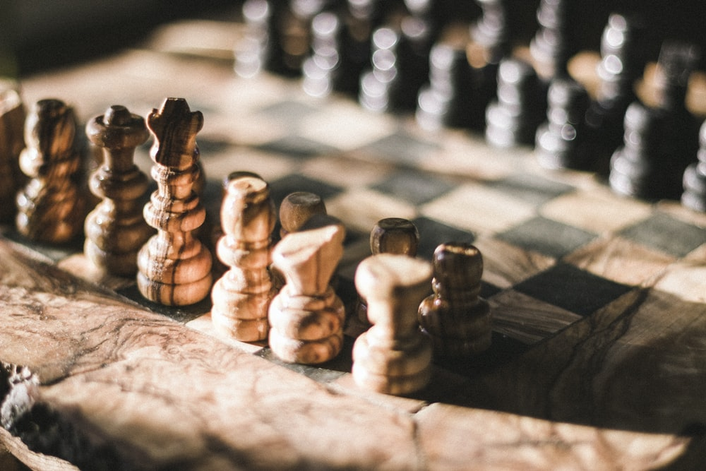 brown and black chessboard closeup photo